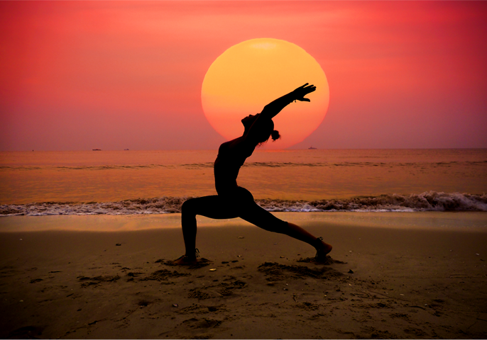 practicing yoga in the evening at CoCobay beach hotel